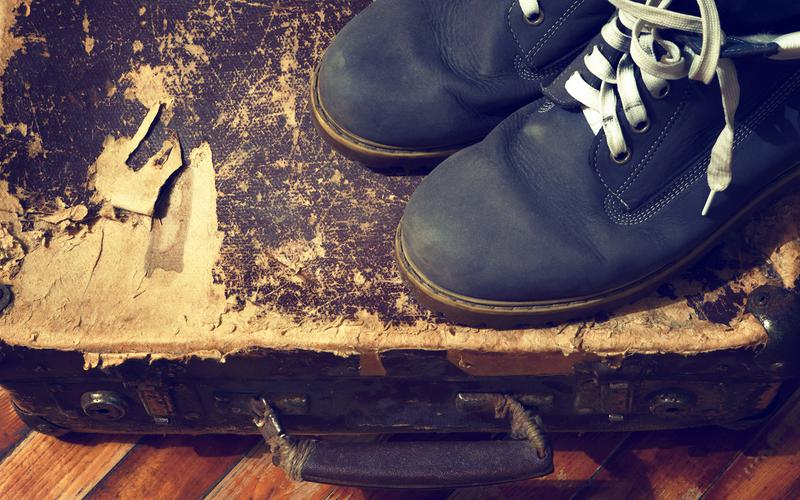 BOOTS AND OLD SUITCASE